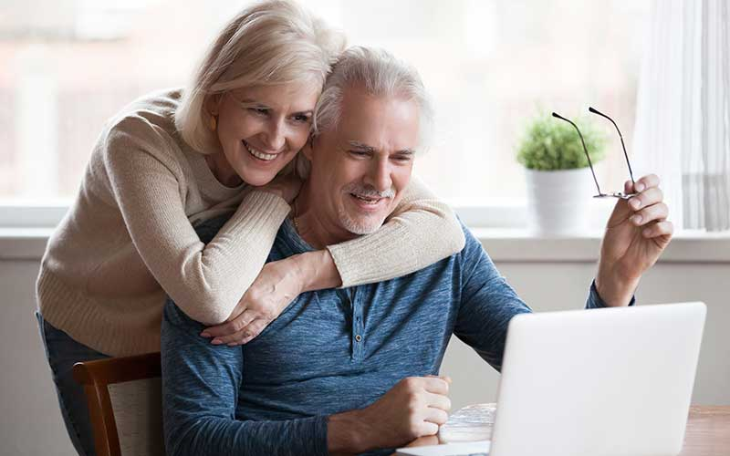 Happy couple on the computer
