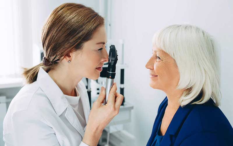 Quigley Eye Specialists physician examining a patient's eyes